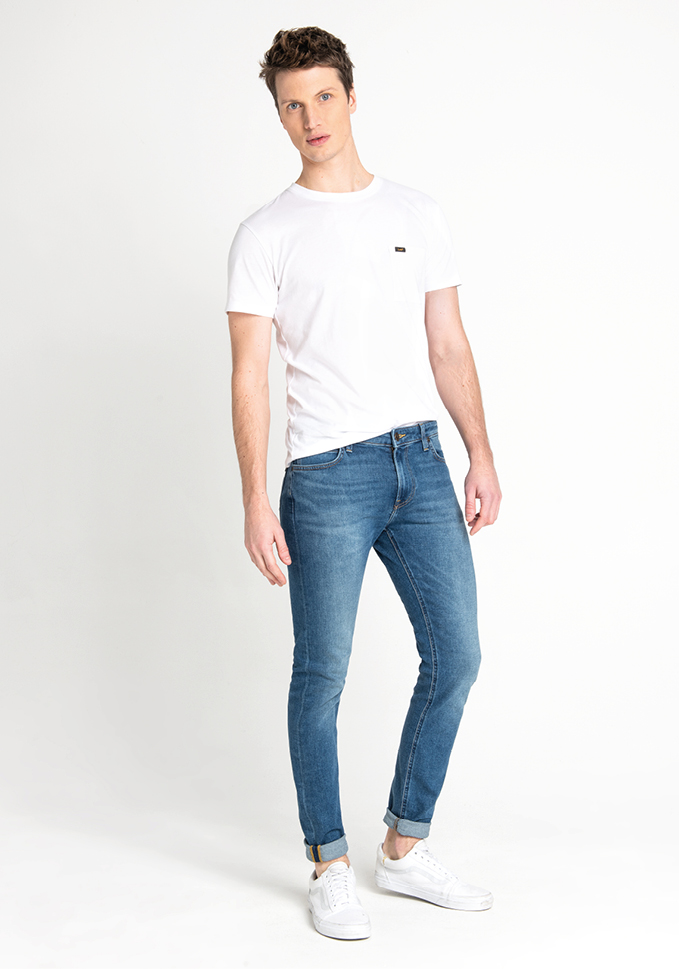 Male model wearing pale denim Lee jeans, part of Lee Denim Wash Guide