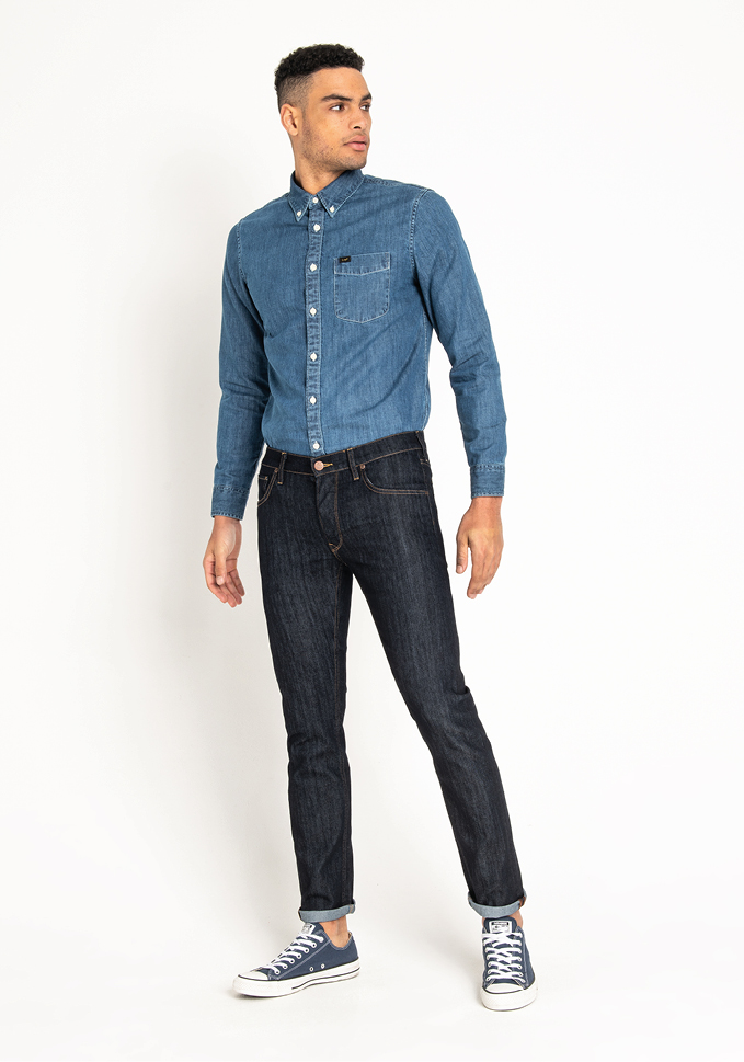 Male model wearing rinse Lee jeans, part of Lee Denim Wash Guide